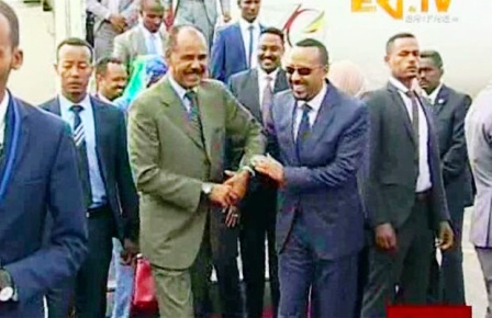 In this grab taken from video provided by ERITV, Ethiopia's Prime Minister Abiy Ahmed, centre right, is welcomed by Eritrea's President Isaias Afwerki as he disembarks the plane, in Asmara, Eritrea, July 8, 2018. With laughter and hugs, the leaders of long-time rivals Ethiopia and Eritrea met for the first time in nearly two decades Sunday amid a rapid and dramatic diplomatic thaw aimed at ending one of Africa's longest-running conflicts. The Associated Press